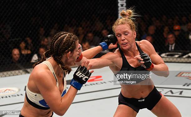 Miesha Tate punches Holly Holm in their UFC women's bantamweight championship bout during the UFC 196 event inside MGM Grand Garden Arena on March 5,...
