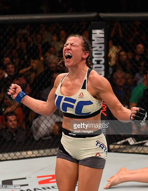 Miesha Tate reacts after her submission victory over Holly Holm in their UFC women's bantamweight championship bout during the UFC 196 event inside...