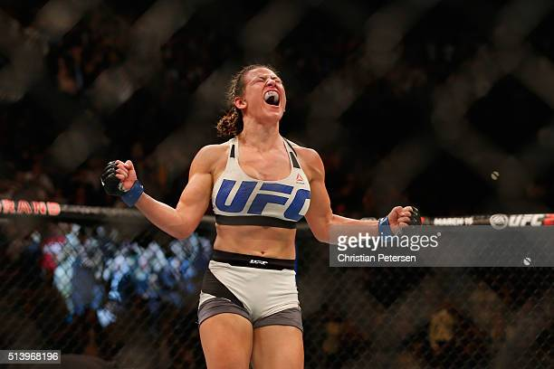 Miesha Tate reacts to her victory over Holly Holm in their UFC women's bantamweight championship bout during the UFC 196 event inside MGM Grand...