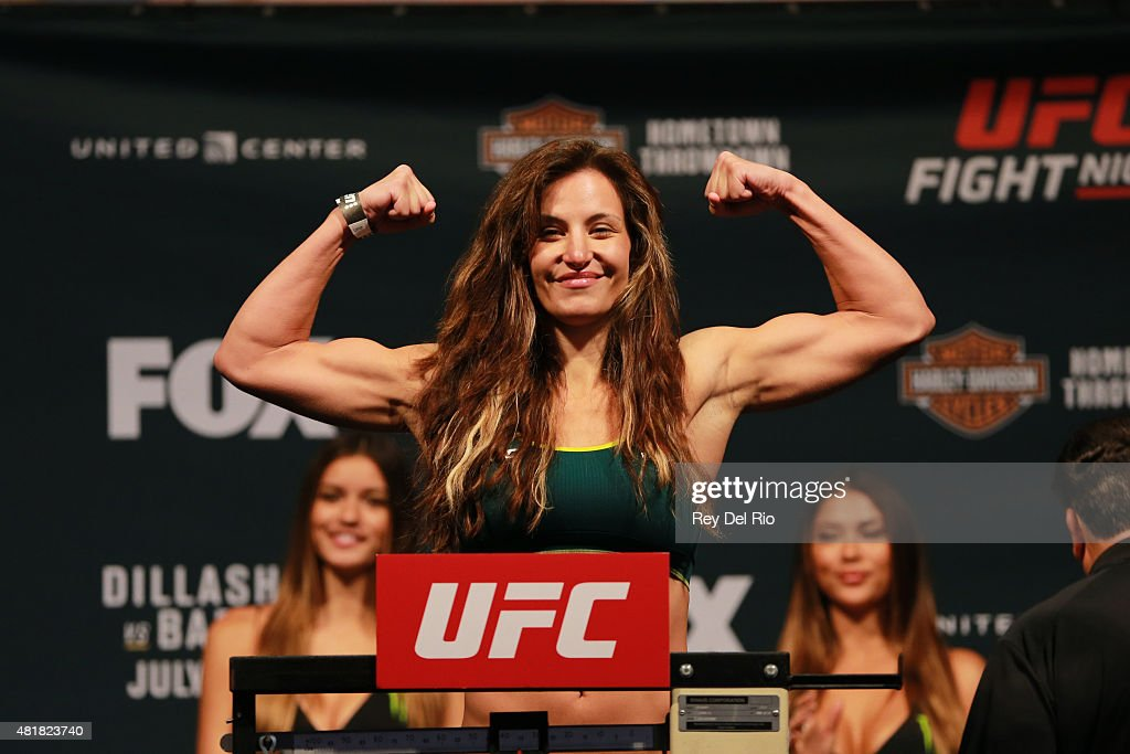 Miesha Tate steps on the scale during the UFC weigh-in at the United Center on July 24, 2015 in Chicago, Illinois.