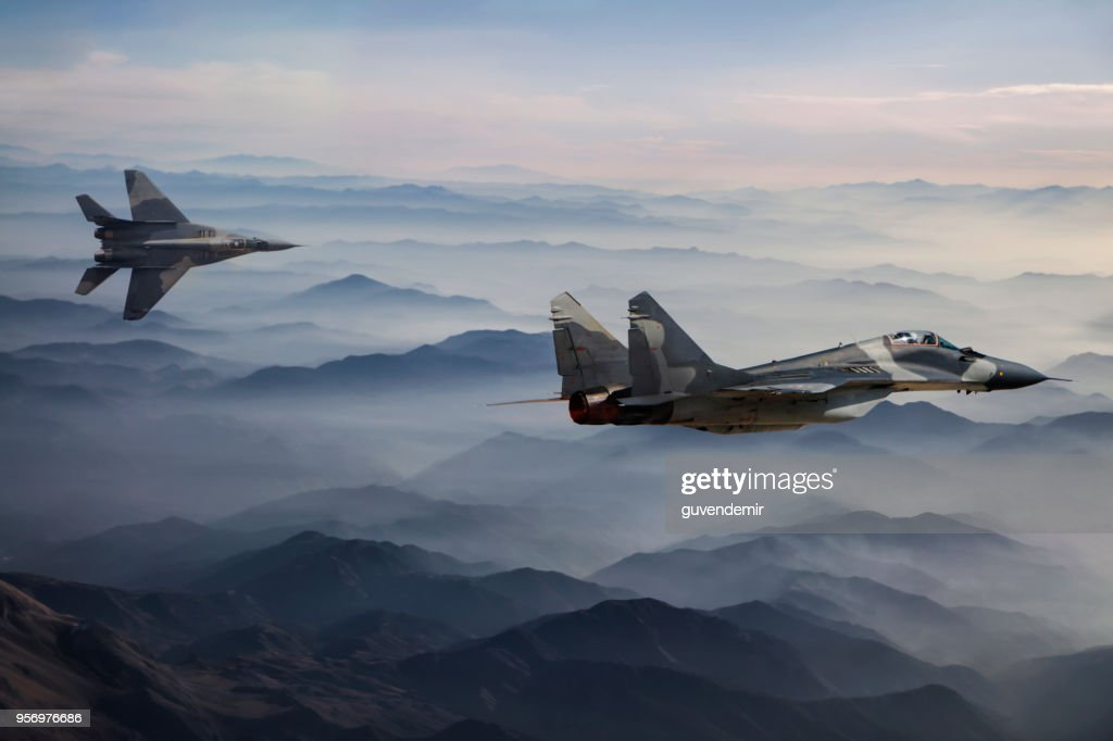 Mig-29 Fighter Jets in Flight above the fogy mountains : Stock Photo