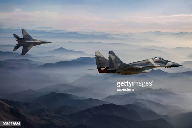 Mig-29 Fighter Jets in Flight above the fogy mountains