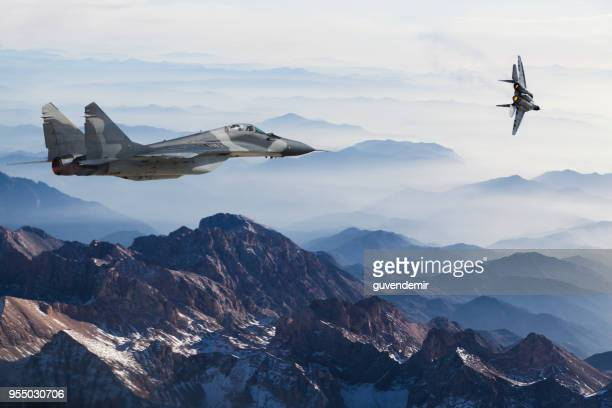 mig-29 fighter jets in flight above the mountains - summits russia 2015 stock pictures, royalty-free photos & images