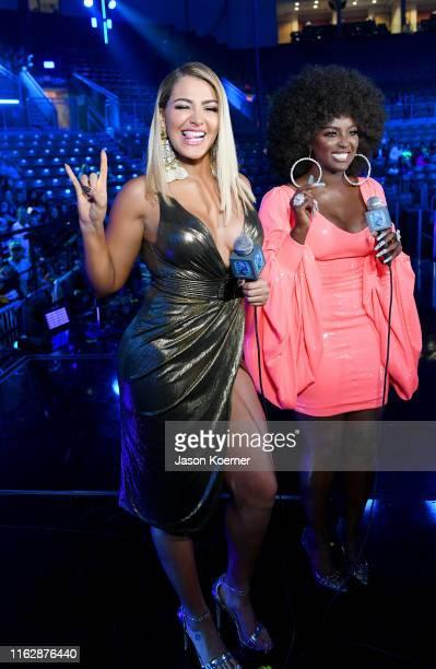 Migbelis Castellano and Amara La Negra speak on stage during Premios Juventud 2019 at Watsco Center on July 18 2019 in Coral Gables Florida