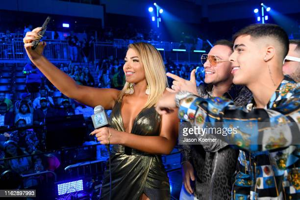 MIgbelis Castellano Chris Jeday and Lunay speak on stage during Premios Juventud 2019 at Watsco Center on July 18 2019 in Coral Gables Florida
