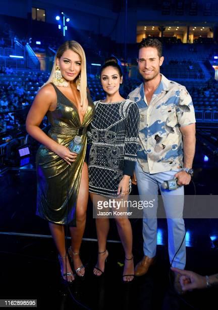 MIgbelis Castellano Renata Notini and Sebastian Ruli speak on stage during Premios Juventud 2019 at Watsco Center on July 18 2019 in Coral Gables...