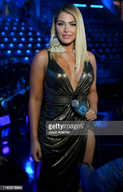 Migbelis Castellano speaks on stage during Premios Juventud 2019 at Watsco Center on July 18 2019 in Coral Gables Florida