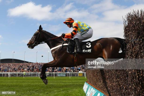 Might Bite ridden by Nico de Boinville clears the last on the way to victory during the Betway Mildmay Novices' Chase on Ladies Day at Aintree...
