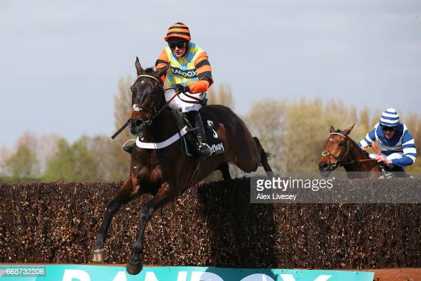 Might Bite ridden by Nico de Boinville clears the second to last on the way to victory during the Betway Mildmay Novices' Chase on Ladies Day at...