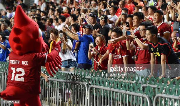 Mighty Red mascot of Liverpool with fans of Liverpool before the Premier League Asia Trophy match between Liverpool FC and Leicester City FC at the...