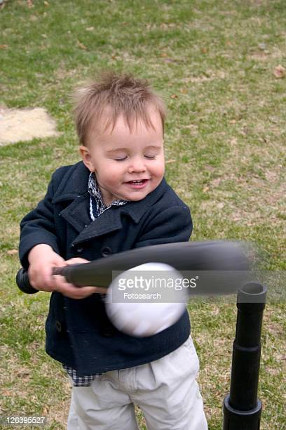 A mighty swing by a very advanced one year old T ball player
