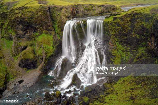 A mighty waterfall in the remote highlands of Iceland