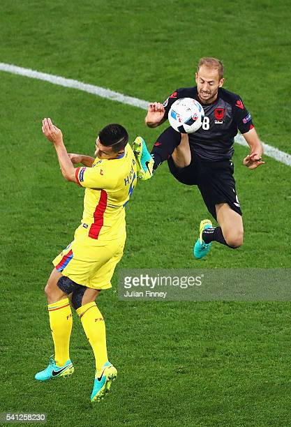 Migjen Basha of Albania and Ovidiu Hoban of Romania compete for the ball during the UEFA EURO 2016 Group A match between Romania and Albania at Stade...