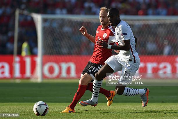 Migjen Basha of Albania tcompetes with Geoffrey Kondogbia of France during the international friendly match between Albania and France at Elbasan...