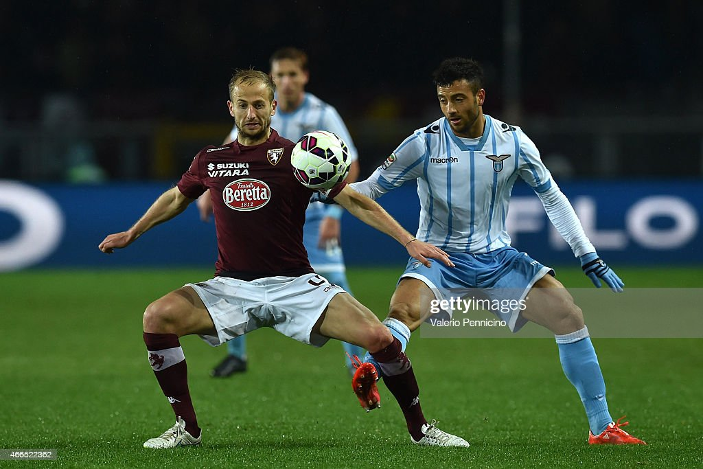 Migjen Basha (L) of Torino FC is challenged by Felipe Anderson of SS Lazio during the Serie A match between Torino FC and SS Lazio at Stadio Olimpico di Torino on March 16, 2015 in Turin, Italy.