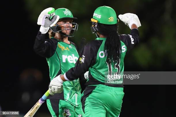 Mignon du Preez and Alana King of the Stars celebrate winning the Women's Big Bash League match between the Brisbane Heat and the Melbourne Stars on...
