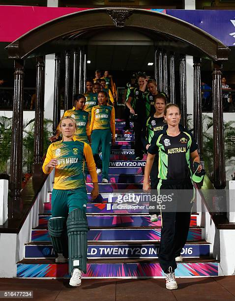 Mignon Du Preez Captain of South Africa and Meg Lanning Captain of Australia lead their teams out onto the pitch during the Women's ICC World...