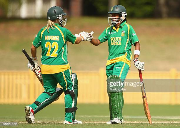 Mignon Du Preez congratulates Trisha Ghetty of South Africa after she scored a half century during the ICC Women's World Cup 2009 round two group...
