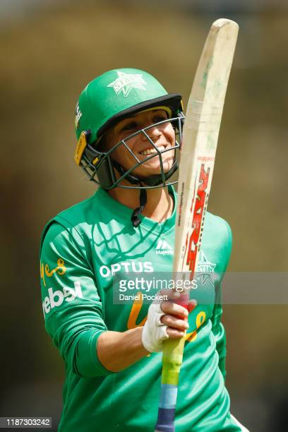 Mignon du Preez of the Stars gestures to teammates as she leaves the field after being dismissed during the Women's Big Bash League match between the...