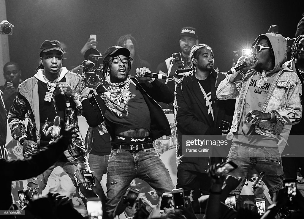 Migos and Lil Uzi Vert perform onstage at Puma & Hot 107.9 presents Migos 'Culture' Album Release Show at Center Stage on January 28, 2017 in Atlanta, Georgia.