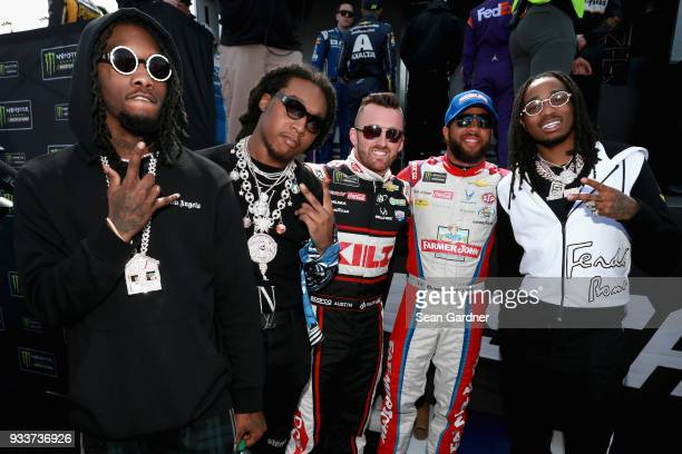 Migos meets with Austin Dillon driver of the Dow Coating Chevrolet and Darrell Wallace Jr driver of the Farmer John Chevrolet prior to the start of...