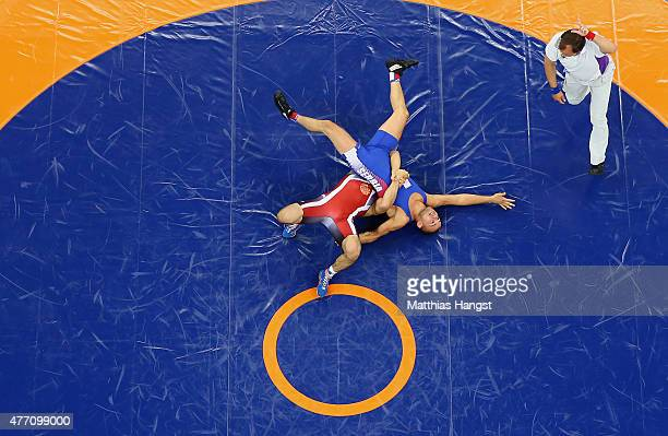 Migran Arutyunyan and Aleksandar Maksimovic of Serbia compete in the Men's Wrestling 66kg Greco Roman quarterfinal during day two of the Baku 2015...