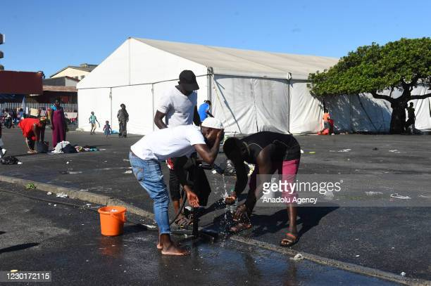 """Migranst who live at Bellville refugee camp in Cape Town, South Africa are seen on December 15, 2020. The """"December 18 International Migrants Day"""",..."""