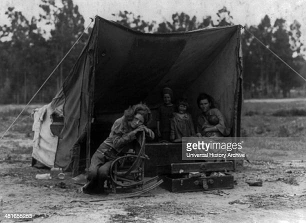 Migrant agricultural worker's family Seven hungry children Mother aged thirtytwo Father is native Californian Nipomo California by Dorothea Lange...