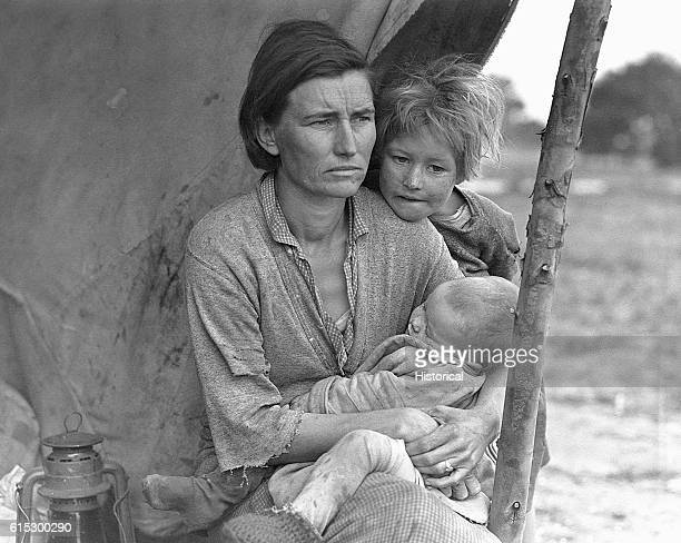 A migrant agricultural worker's wife and children in a camp Nipomo California March 1936