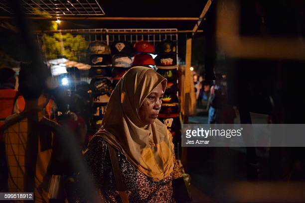 Migrant and local merchants setup their stalls as the local government ordered to reopen the night market that was ground zero for a deadly bomb...