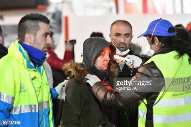 A migrant at the medical check during the landing by ship Diciotti of the Italian Coast Guard occurred in the port of Crotone in Calabria southern...