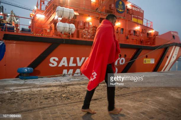 Migrant Bare feet disembarking the Spanish vessel to go to the CAre Unit On 7 December 2018 in Malaga Spain The Spanish Maritime vessel the quotSAR...