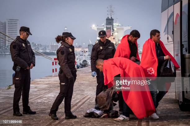 A migrant being asked to open his bags before getting on the bus On 7 December 2018 in Malaga Spain The Spanish Maritime vessel the quotSAR...
