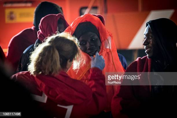 A migrant being attended by a staff of the red cross team Malaga The Spaniard Maritime vessel rescued in the Mediterranean sea 202 migrants They were...