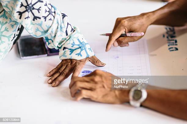 Migrant Cambodian workers register their names and leave their fingerprints with Thai military personnel before they are transported to the border...