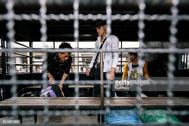 Migrant Cambodians working in Thailand are transferred to the border by Immigration Police before they return home during a mass exodus Aranyaprathet...