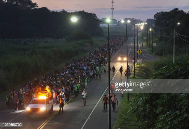 A migrant caravan walks into the interior of Mexico after crossing the Guatemalan border on October 21 2018 near Ciudad Hidalgo Mexico The caravan of...