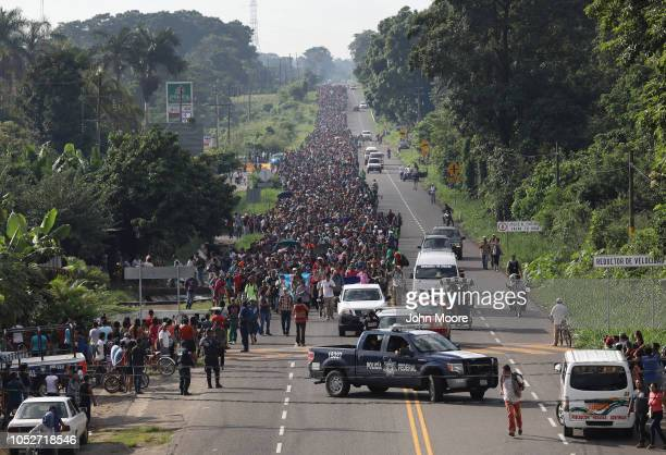 A migrant caravan which has grown into the thousands walks into the interior of Mexico after crossing the Guatemalan border on October 21 2018 near...