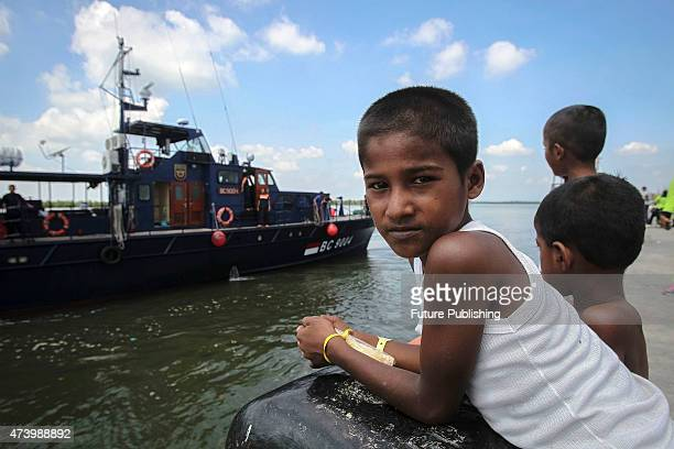 A migrant child from Myanmar seen outside at a camp shelters in the fishing port of Kuala Langsa in Aceh on May 19 2015 in Kuala Langsa Indonesia...