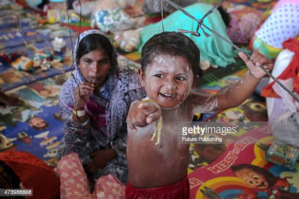 A migrant child from Myanmar seen playing at a camp shelters in the fishing port of Kuala Langsa in Aceh on May 19 2015 in Kuala Langsa Indonesia...