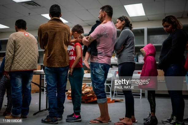 Migrant children from different Latin American wait to receive food at the Casa del Refugiado or The House of Refugee a new centre opened by the...