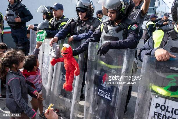 TOPSHOT Migrant children part of the Central American migrants mostly from Honduras moving towards the United States play with Mexico's Federal...