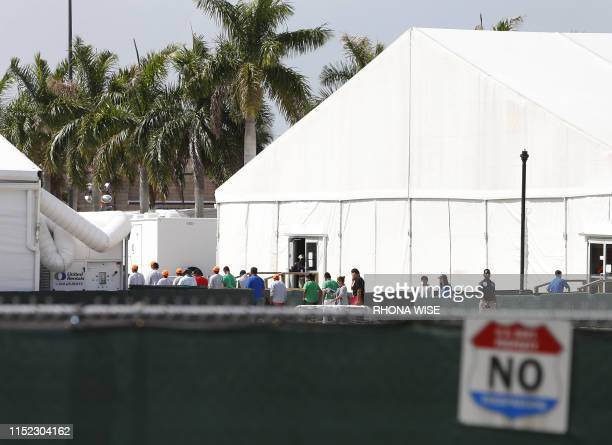 Migrant children who have been separated from their families can be seen in tents at a detention center in Homestead Florida on June 27 2019 Public...