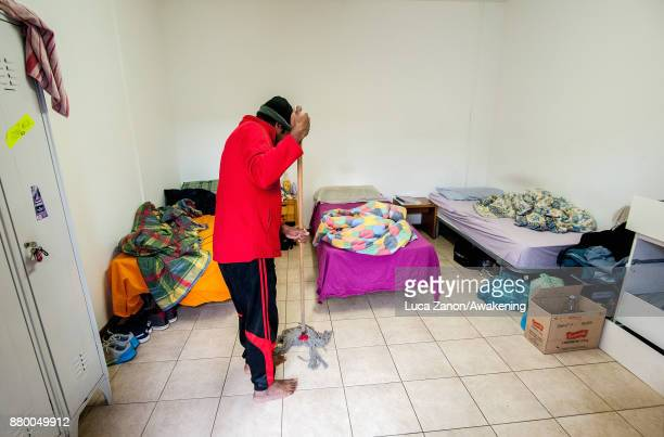 A migrant cleans his room in the 'CAS' center at the Caracol cooperative on November 27 2017 in Venice Italy The Caracol center hosts only migrant...