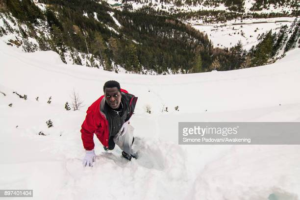 A migrant climbs Colle della Scala during an attempt to reach the French border on December 22 2017 in Bardonecchia Turin Italy After the police...