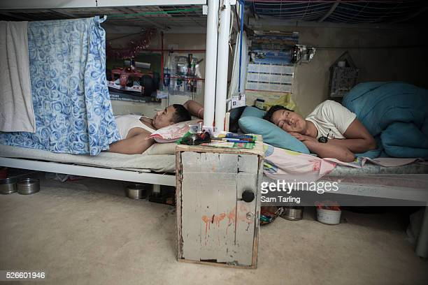 Migrant construction workers sleep in their bunkbeds in a shared room at a workers' camp in alKhor Qatar on June 17 2011 According to the advocacy...