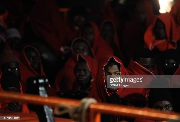 A migrant covered in blanket seen arriving at the port of Malaga onboard a pish coast guard's boat Arrival of a group of migrants rescued in the...