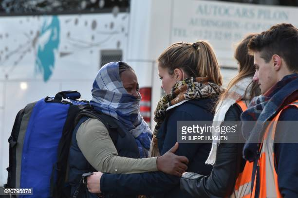 A migrant cries as she leaves the Jules Ferry reception centre next to the recently demolished Jungle migrant camp after a massive operation to clear...