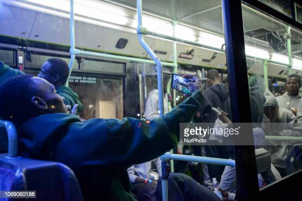 A migrant doing a selfie inisde a bus while waitng to be transferred to a center Malaga
