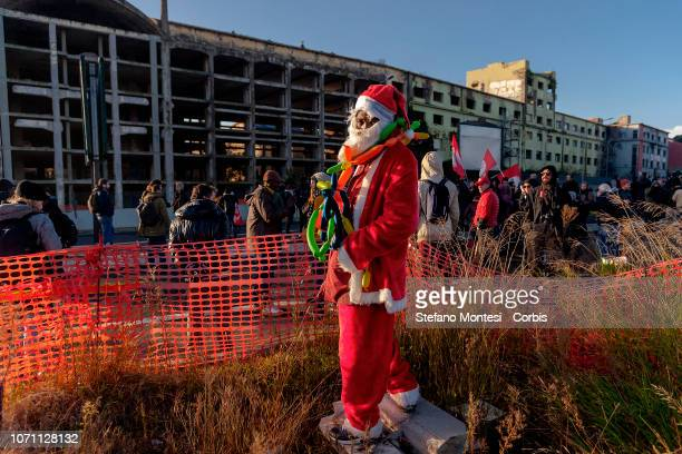 A migrant dressed as Santa Claus stands outside the building during the evacuation of a former penicillin factory where migrants from Africa but also...